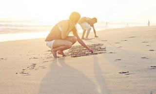 escribir en la arena